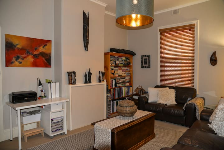 Living Room with plenty of seating, mood lighting, large smart TV with, Netflix & AppleTV.  The latest paid moves available at an additional fee. There is a bookcase with plenty of reading material to enjoy. Plus a desk if you need somewhere to work.