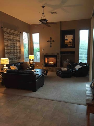 Our family room is a comfortable, open space adjacent to the kitchen.  We have a natural gas fireplace, including a fan that helps warm the room during cool desert mornings and evenings.