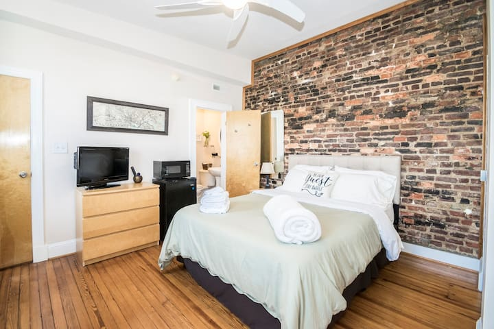 """Perfect for a quick quaint getaway, or business trip that might require some late night prepping. There's television, microwave, mini fridge, and a cozy desk with a lamp. Also a ton of closet space.""  -David"
