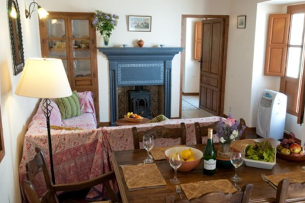 The living-dining room is full of character.