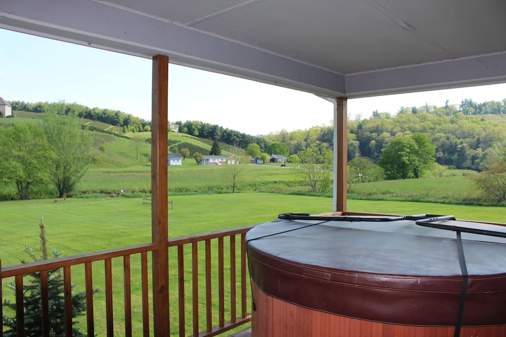 Hot tub and rocking chairs on the back porch
