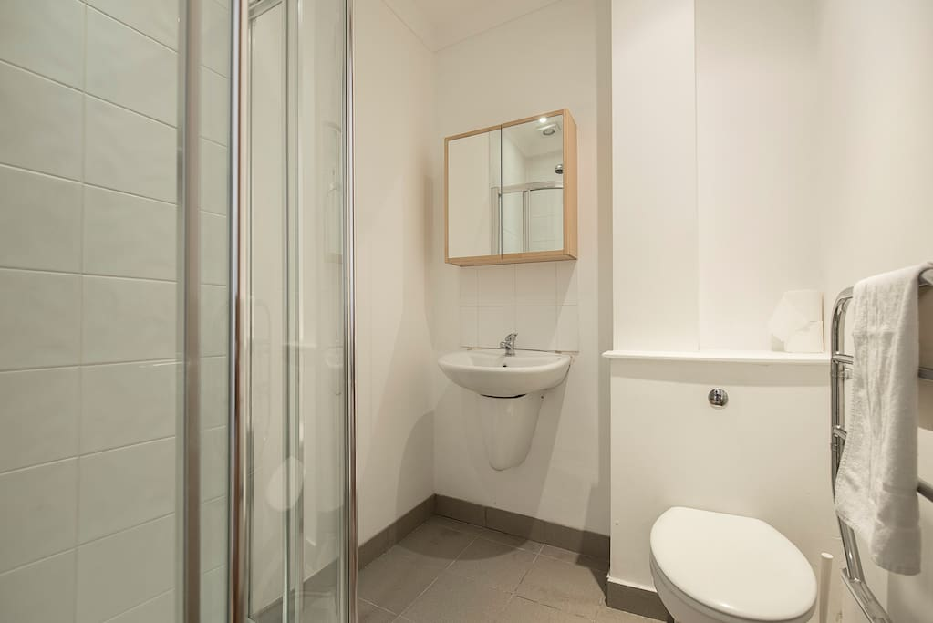 Private bathroom with power shower and heated towel rail.