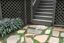 Steps up to the deck where entrance to our space is located.
