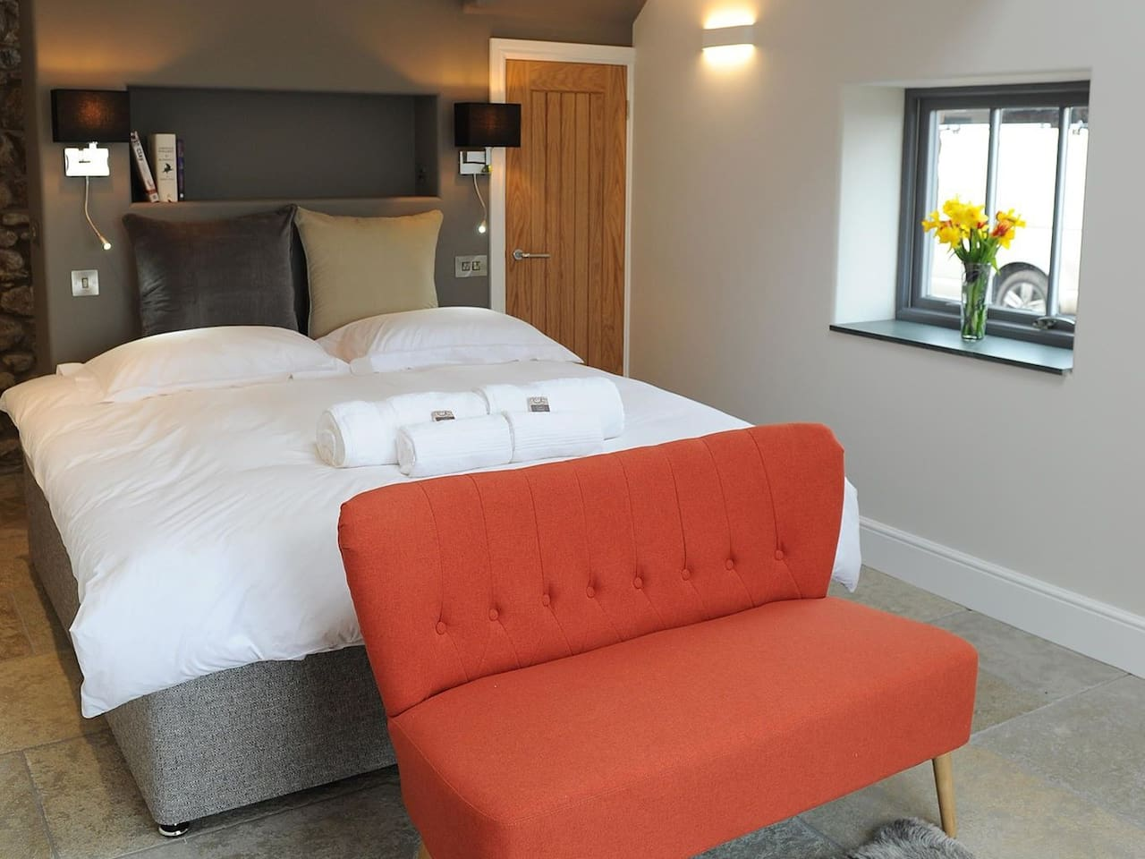 Stone Suite has a Superking size bed and mezzanine bathroom with copper coloured bath