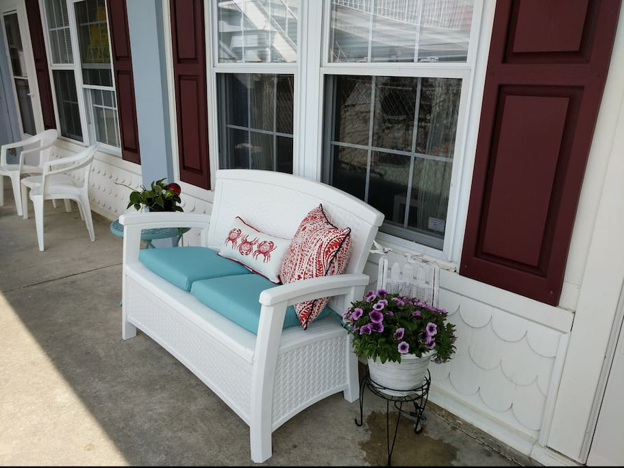 Enjoy coffee or a glass of wine out front.