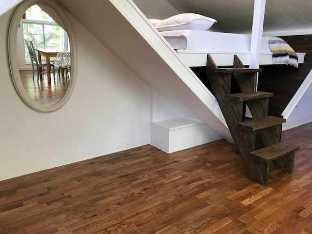 1920s restored wood in the lofted bed. New set of custom stairs, and a comfy memory foam queen mattress.
