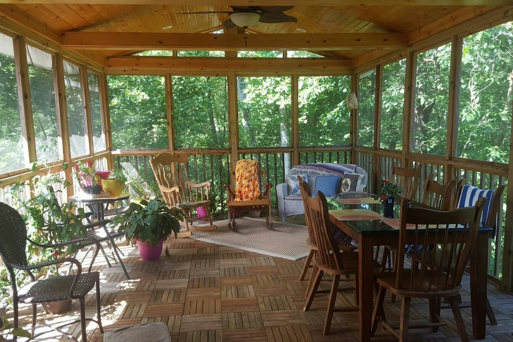 Enjoy a tranquial setting of a one of a kind outdoor patio room with wooded views.