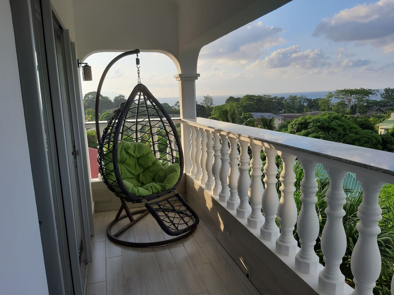 Private balcony of apt 2 overseeing Beau Vallon Beach and the ocean