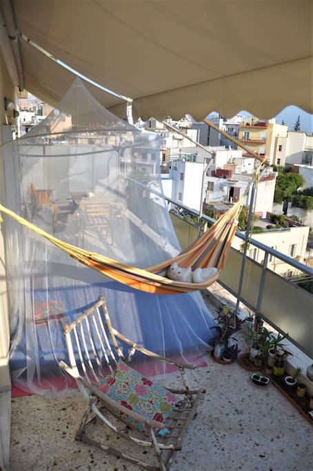 In summer you can sleep outside too on the balcony above the roofs of Athens