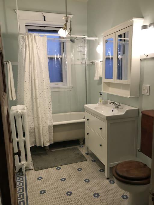 Bathroom with original porcelain tub and toilet
