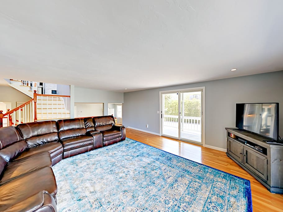 """Gather in the bright 1st-floor living room on the large reclining sectional sofa for a movie on the 50"""" flat screen TV with Blu-ray player."""