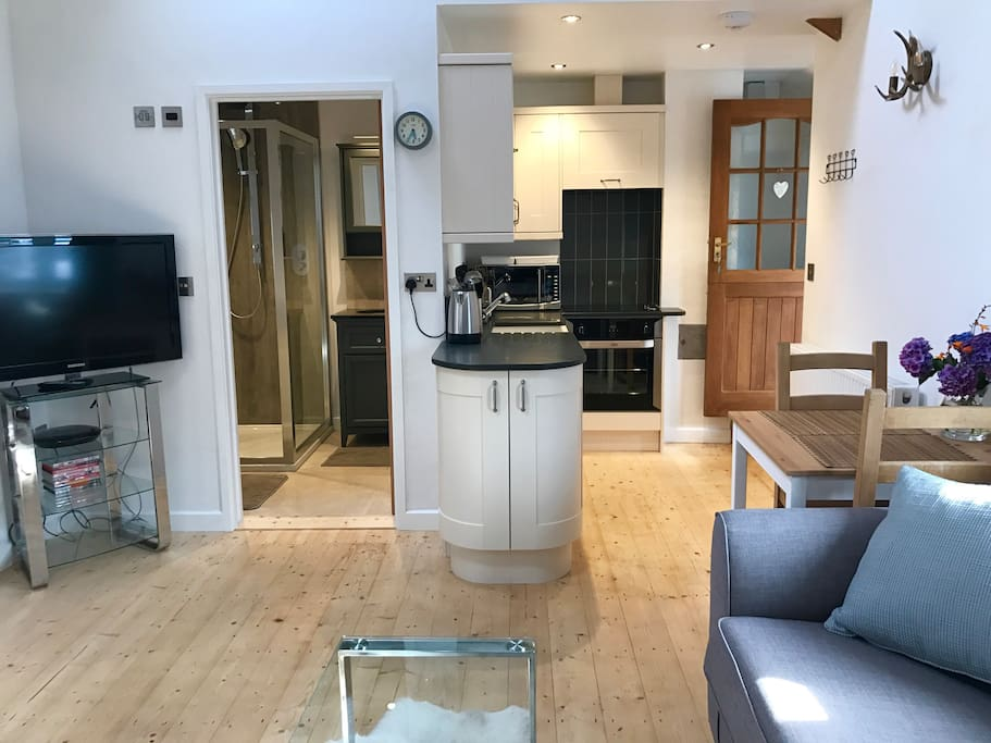 Beautiful well equipped kitchen with slate worktops, fridge, cooker. TV and DVD player.