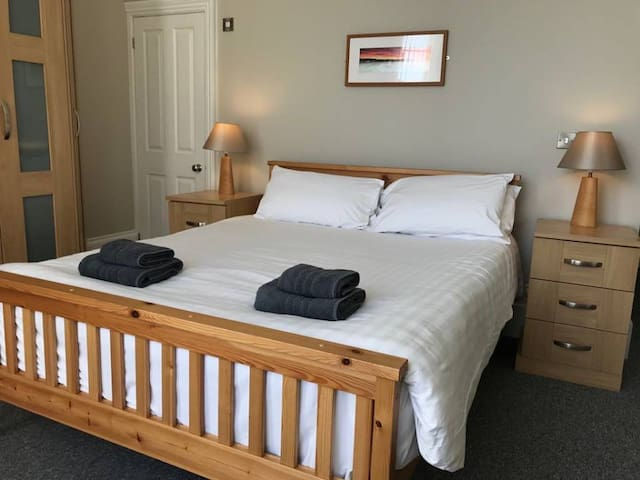 Our King bedroom is spacious, offers ample storage, has its own ensuite and overlooks the garden