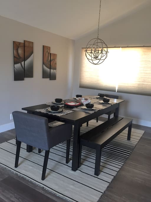 Beautiful modern-contemporary dining room. Seats 8 total; all inclusive with silverware/tableware for each guest. (Only 6 pictured, 2 additional are readily available)