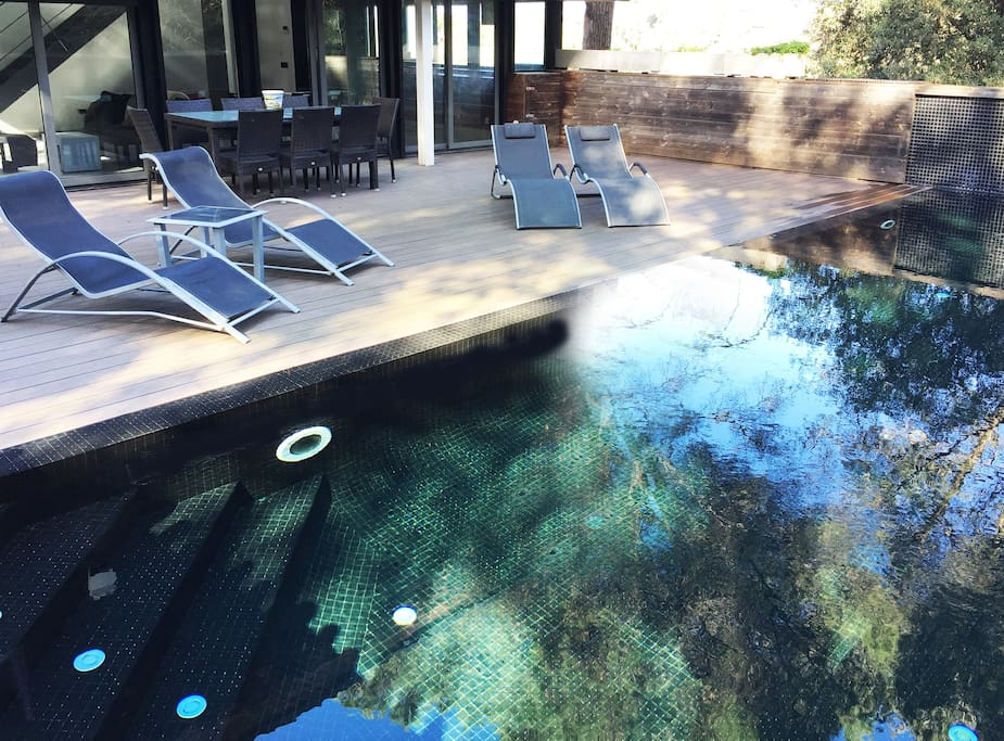 Chill-out private terrace & pool. Additional outdoor dining setup. Sun loungers. By the mountain.