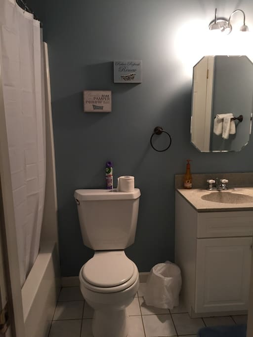 Clean and spacious bathroom with its own linen/towel closet
