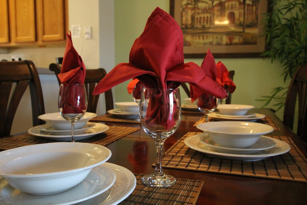 Dinnerware, glassware, and utensils for up to 8 guests.