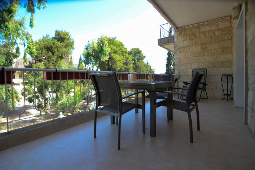 Features a large terrace, stunning view, furnished with comfortable extendable patio dining and lounge chairs.