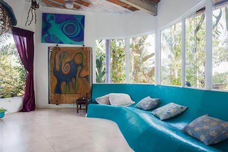 Greenroofed ecohouse inside tropical gardens - Niterói