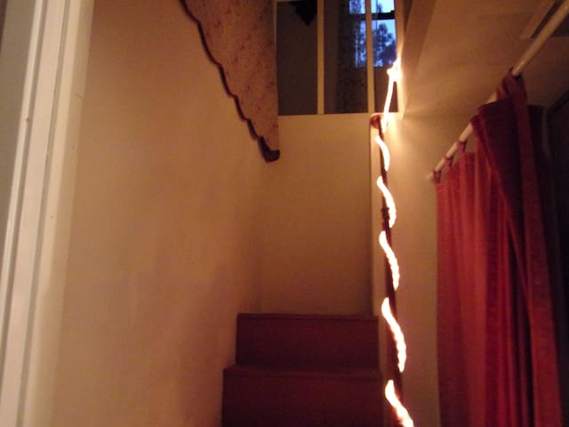 Stairs to loft lit at night.