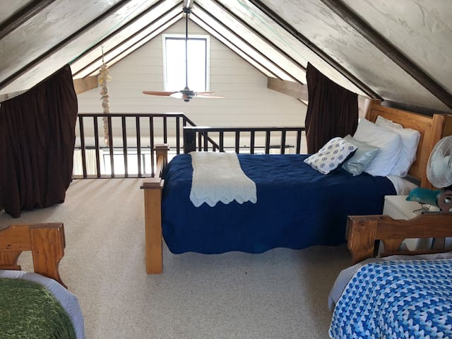 The 3rd bedroom/loft.  3 twin beds.  Curtains pull up for privacy