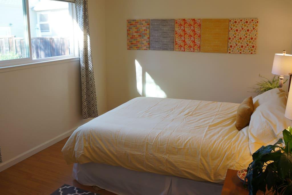 West-facing bedroom with queen size bed.