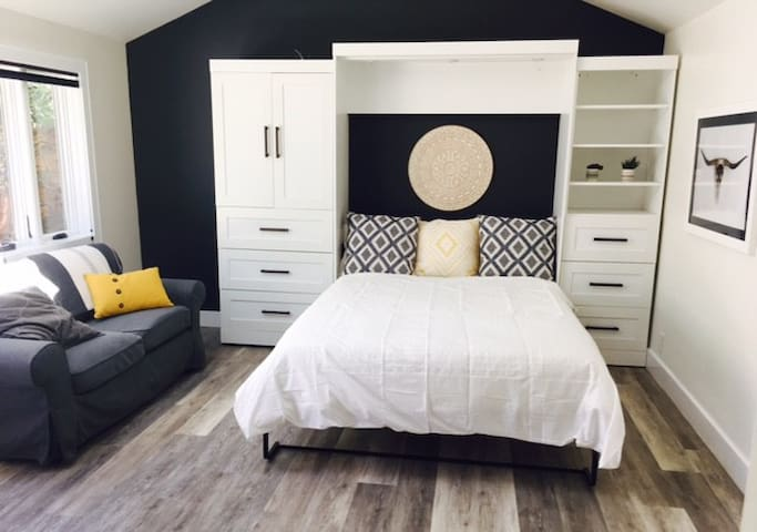 Queen size bed with plenty of storage  including hanging space, plus a comfy sofa