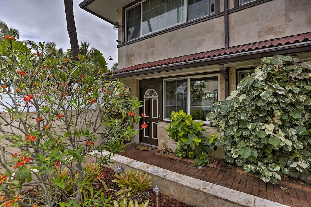 Lush plantings and tropical flora greet you when you arrive at the property.