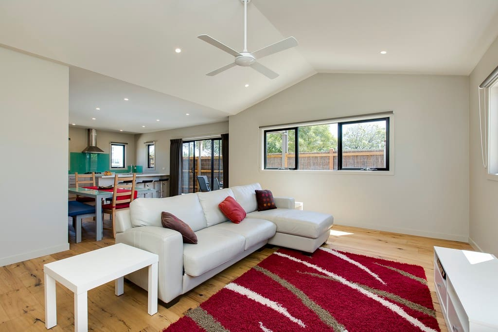 Down stairs living area with flat screen Tv and foxtell which interconnects to main bedroom