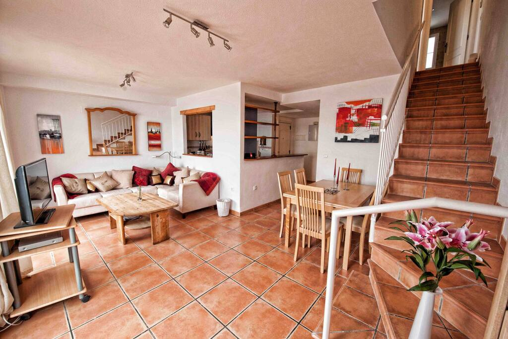 Open plan living area - stairs to upper floor