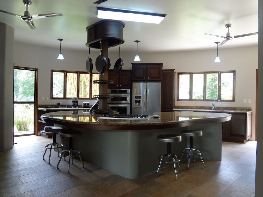 Large professional kitchen with bar seating