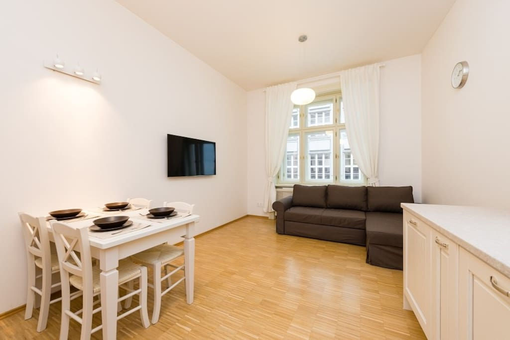 Fully equipped kitchen with dinning table + foldout sofa.