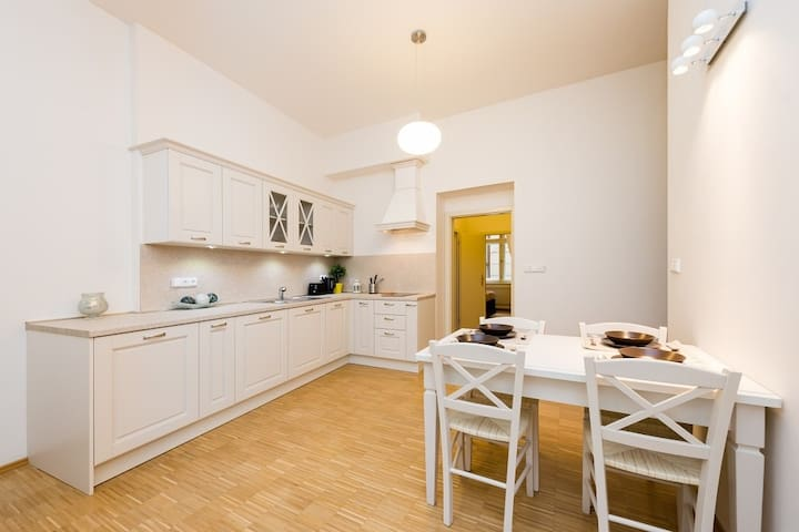 Fully equipped kitchen with dinning table.
