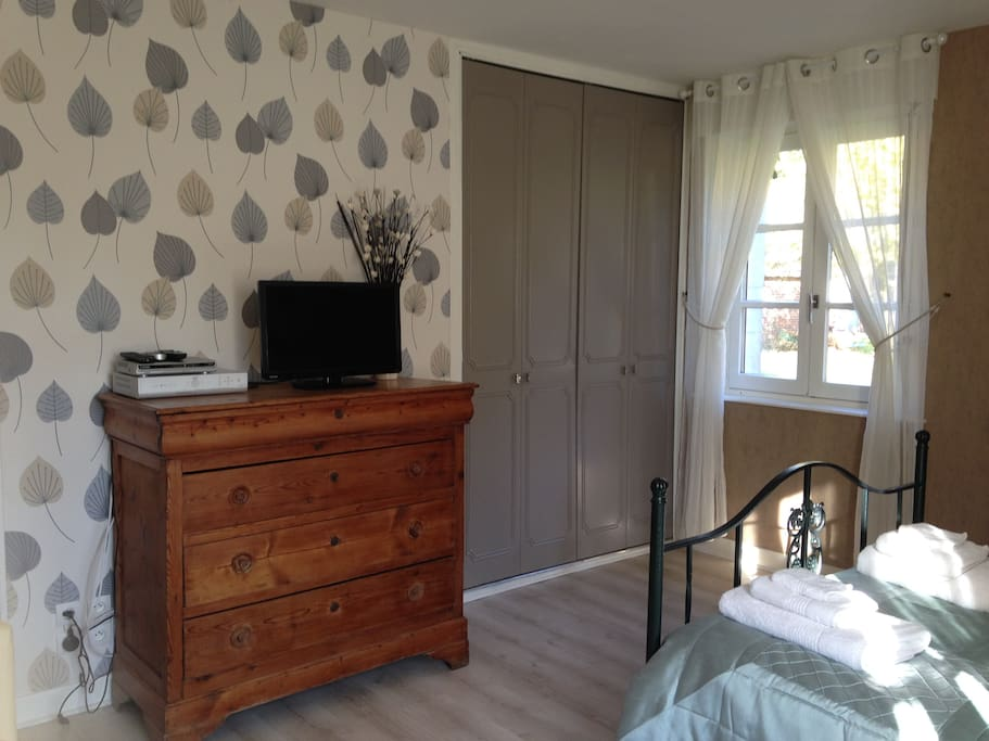 There is a double wardrobe, chest of drawers and TV/DVD.