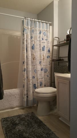 Full bathroom just steps from bedroom door. Tub/shower, sink, elongated/elevated toilet, linens and more await.