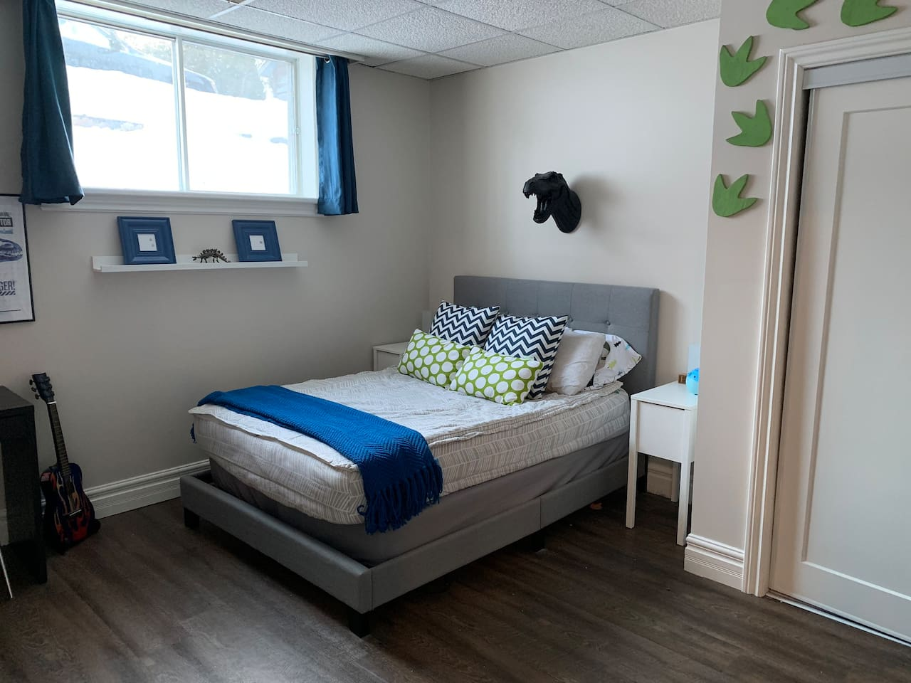 Large bedroom with a comfortable double bed, ample pillows, salt lamp, sound machine and essential oil diffuser.