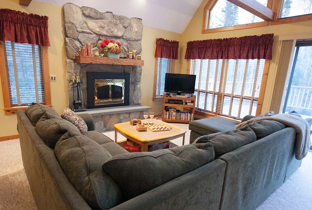 Beautiful field stone fireplace complements the cozy decor.