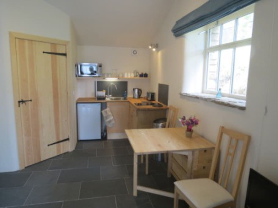 The kitchen is fully equipped with all you need and there is a dining table and chairs.
