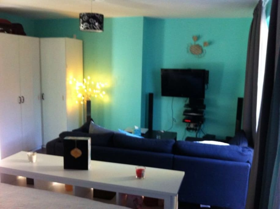 Double room with sofa and tv