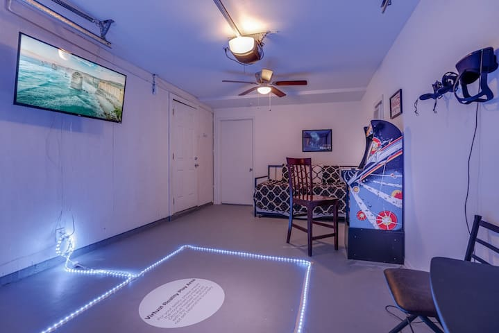 Our garage turned mini arcade features an Occulus Quest Virtual Reality Headset that is preloaded with games. Also featuring an old-school Astroids arcade machine, smart TV and a trundle style bed that turns into two twin beds!