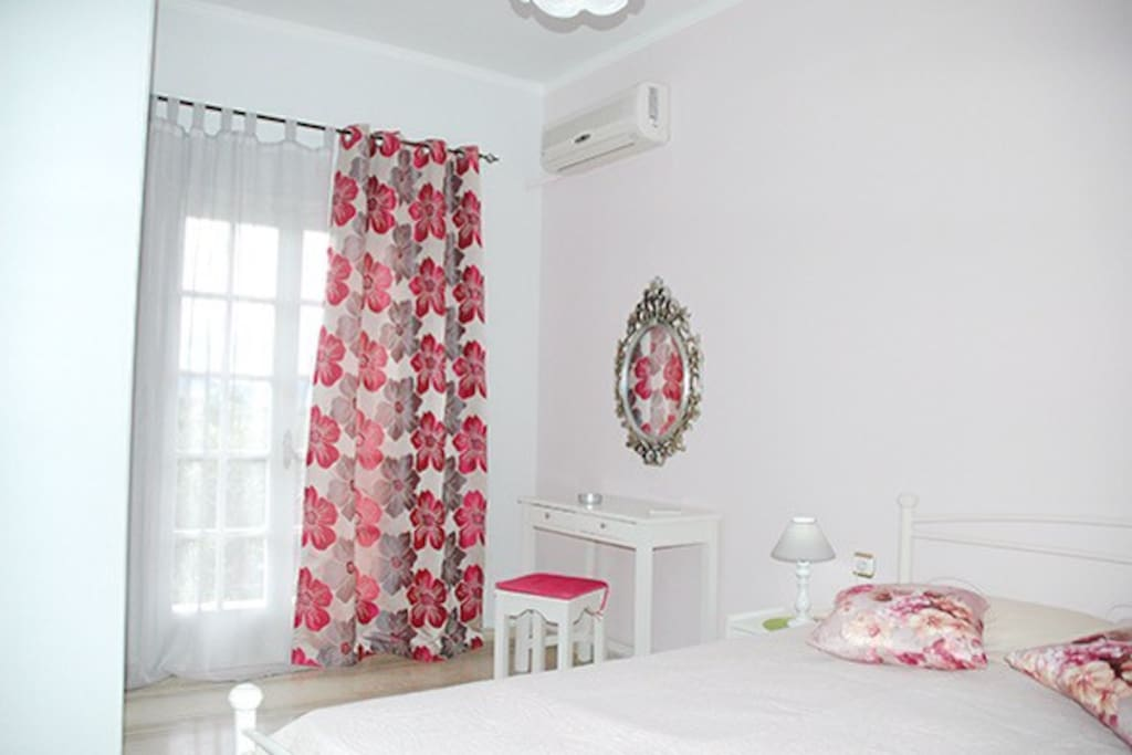 The bedroom with double bed, wardrobe, aircondition.