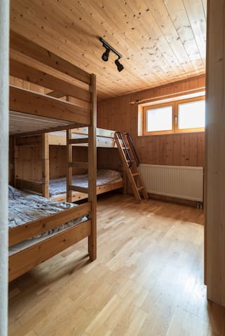 Spare bedroom with two bunk beds.