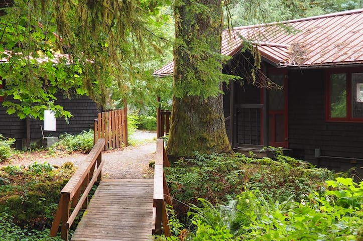 The bridge behind the cottage leads to the park area.