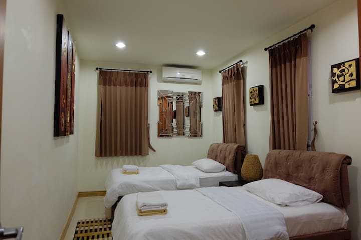 -4th Bedroom is on ground floor,with 2 single beds and 2 move-able extra beds, bathroom is in common bathroom