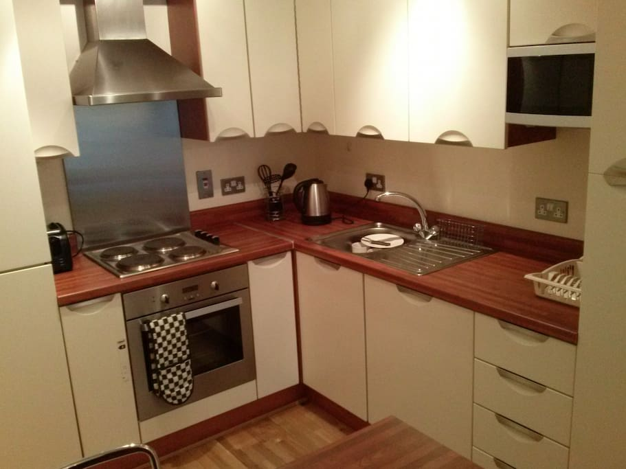 fully equipped kitchen with dish washer, micro wave...