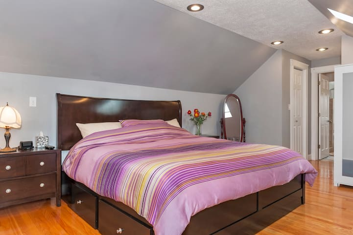 Second floor master suite with king sized bed