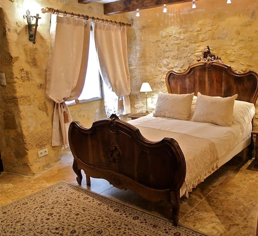 Newly finished Louis XV Bedroom bathed in local honey-colored stone