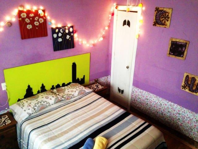 Colourful cozy bedroom in 2 floor house in Condesa