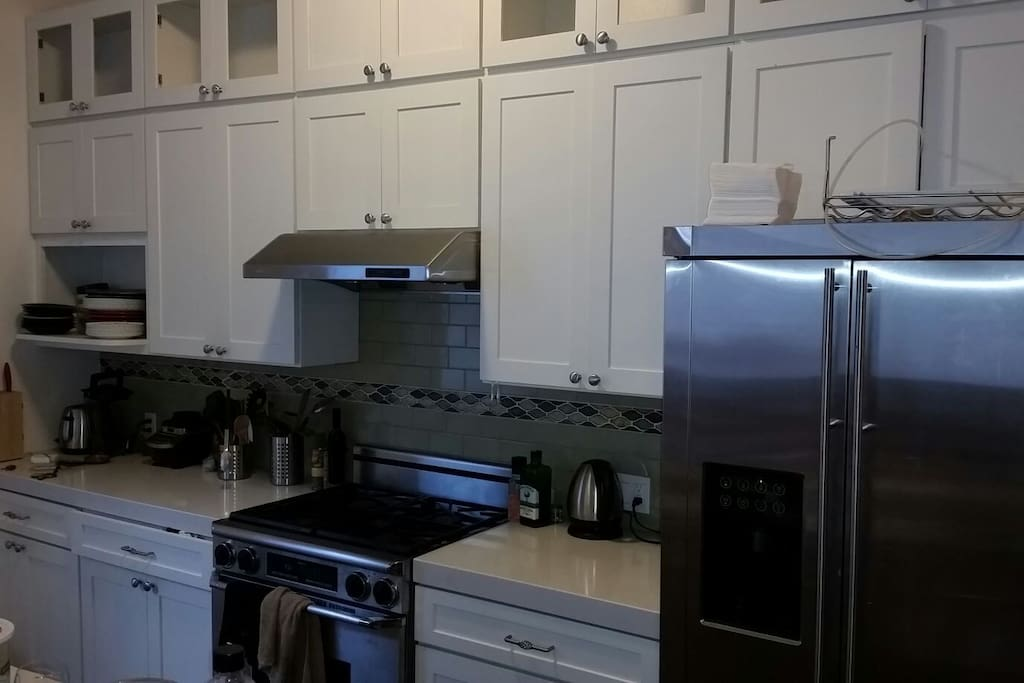 stainless steel kitchen with granite counters