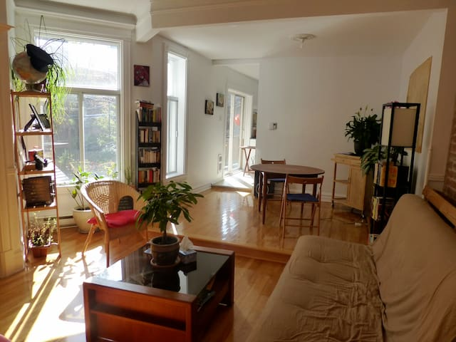 The livingroom is big and very bright.
